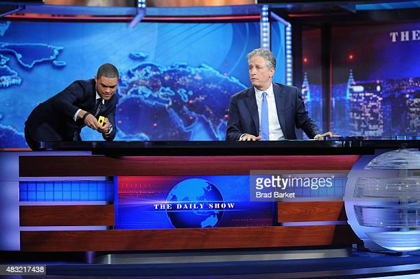 Trevor Noah and host Jon Stewart appear on 'The Daily Show with Jon Stewart' #JonVoyage on August 6 2015 in New York City