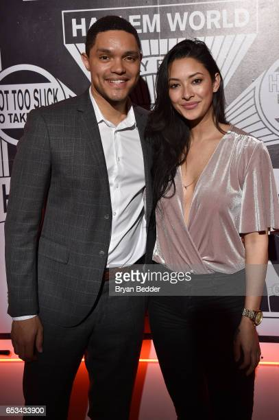 Trevor Noah and Jordyn Taylor attend Experience Harlem hosted by Airbnb and Ghetto Gastro on March 14 2017 in New York City