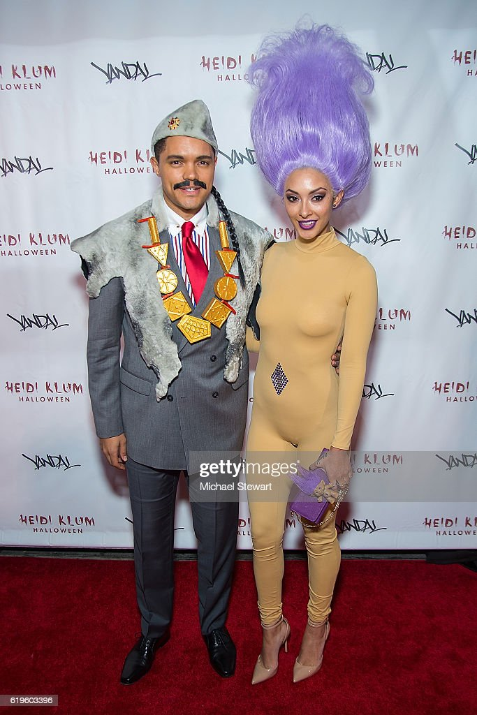 Trevor Noah (L) and Jordyn Taylor attend Heidi Klum's 17th Annual Halloween party at Vandal on October 31, 2016 in New York City.