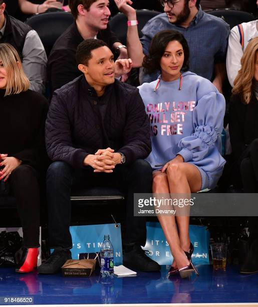 Trevor Noah and Jordyn Taylor attend the New York Knicks vs Washington Wizards game at Madison Square Garden on February 14 2018 in New York City
