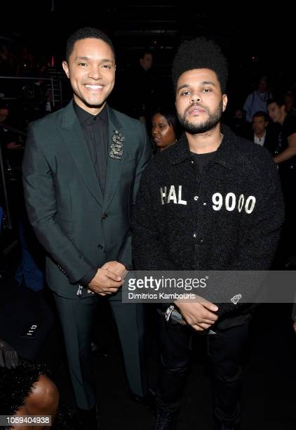 Trevor Noah and The Weeknd attend the 2018 Victoria's Secret Fashion Show in New York at Pier 94 on November 8 2018 in New York City