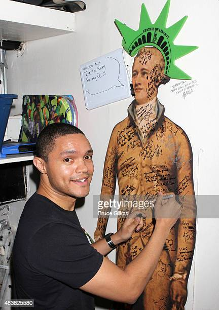 Trevor Noah poses backstage at the hit musical 'Hamilton' on Broadway at The Richard Rogers Theater on August 13 2015 in New York City