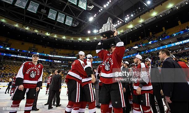 Trevor Owens of the Northeastern Huskies celebrates as the Northeastern Huskies win the Hockey East Championship during NCAA hockey in the Hockey...