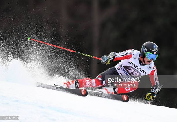 Trevor Philp from Canada competes during the men's Giant Slalom first run at the FIS Alpine Skiing World Cup in GarmischPartenkirchen southern...