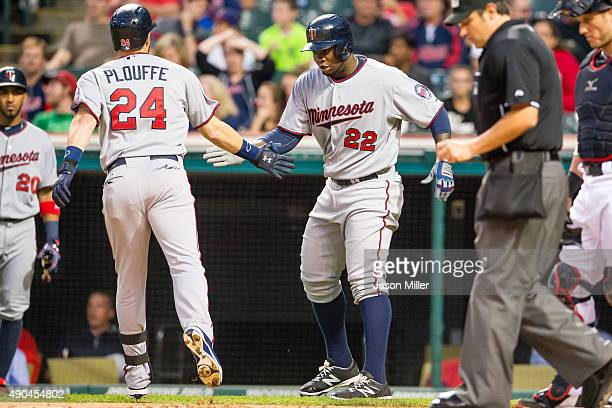 Trevor Plouffe celebrates with Miguel Sano of the Minnesota Twins after Plouffe hit a two run home run during the first inning against the Cleveland...