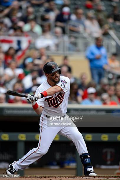 Trevor Plouffe of the Minnesota Twins bats against the Kansas City Royals during the game on April 16 2015 at Target Field in Minneapolis Minnesota