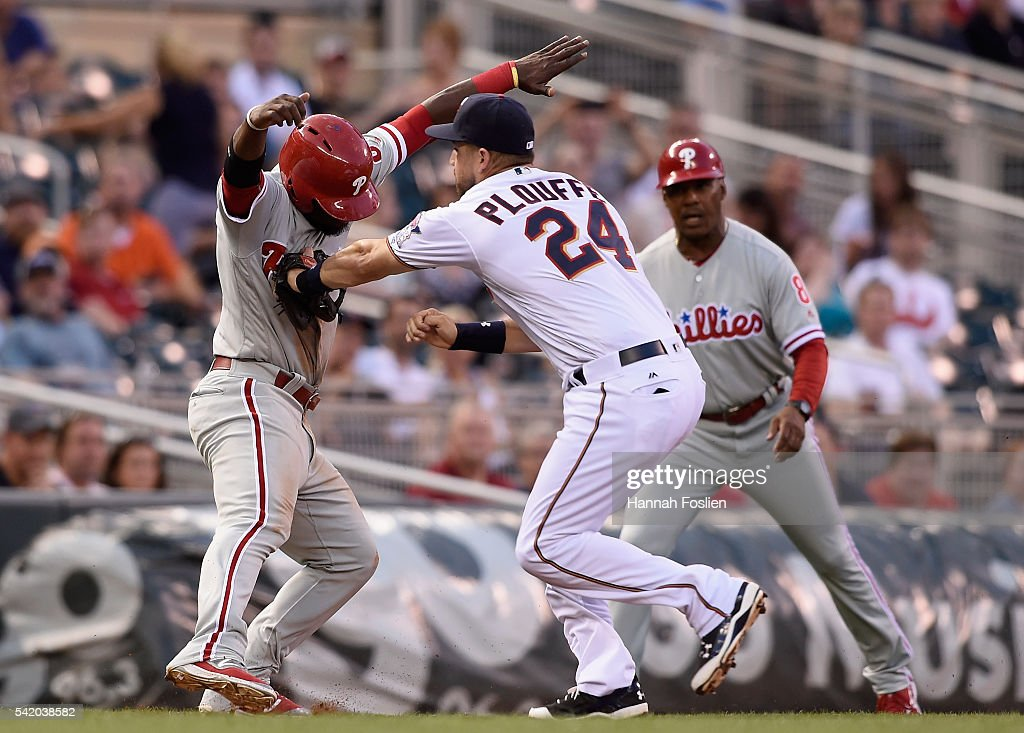 Trevor Plouffe #24 of the Minnesota Twins catches Odubel Herrera #37 of the Philadelphia Phillies off third base during the fourth inning of the game on June 21, 2016 at Target Field in Minneapolis, Minnesota. The Twins defeated the Phillies 14-10.