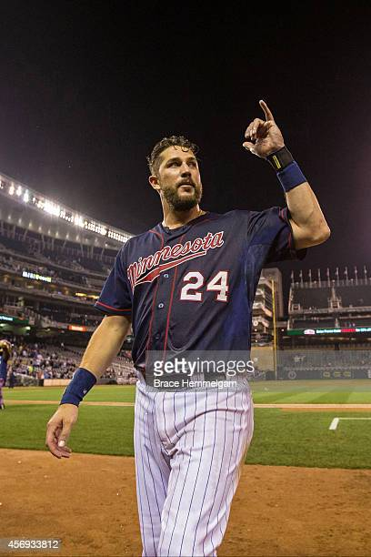 Trevor Plouffe of the Minnesota Twins celebrates against the Cleveland Indians on September 19 2014 at Target Field in Minneapolis Minnesota The...