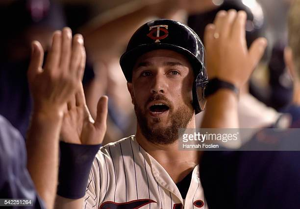 Trevor Plouffe of the Minnesota Twins celebrates scoring a run against the Philadelphia Phillies during the seventh inning of the game on June 22...