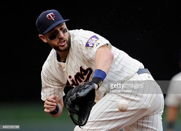 Trevor Plouffe of the Minnesota Twins fields a ground ball by Matt Dominguez of the Houston Astros before throwing to first base to get the out...