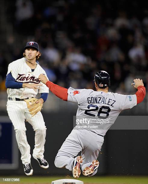 Trevor Plouffe of the Minnesota Twins gets Adrian Gonzalez of the Boston Red Sox out at second base as Plouffe turns a double play during the sixth...