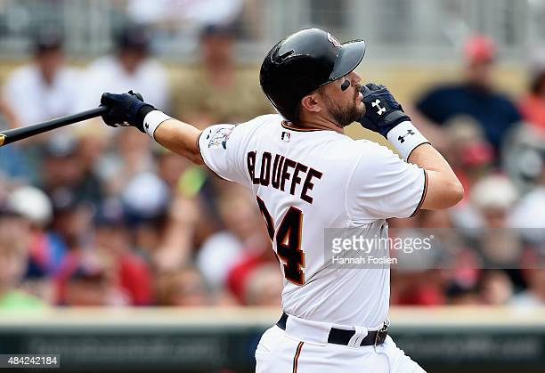 Trevor Plouffe of the Minnesota Twins hits a solo home run against the Cleveland Indians during the eighth inning of the game on August 16 2015 at...