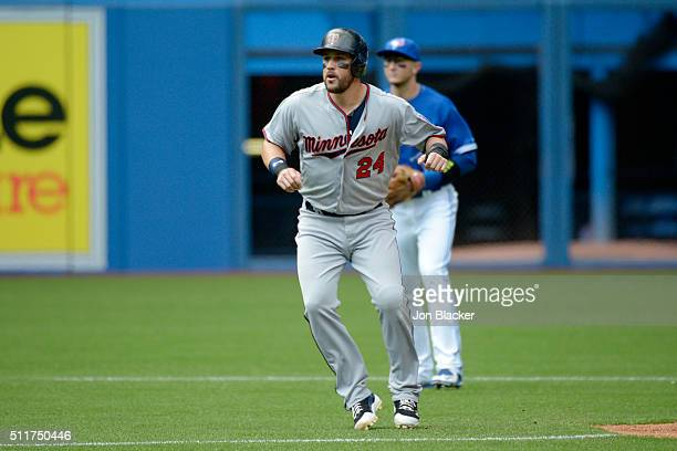 Trevor Plouffe of the Minnesota Twins leads off second base during the game against the Toronto Blue Jays at the Rogers Centre on Monday August 3...