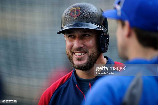 Trevor Plouffe of the Minnesota Twins looks on during batting practice before the game against the Kansas City Royals on August 15 2014 at Target...