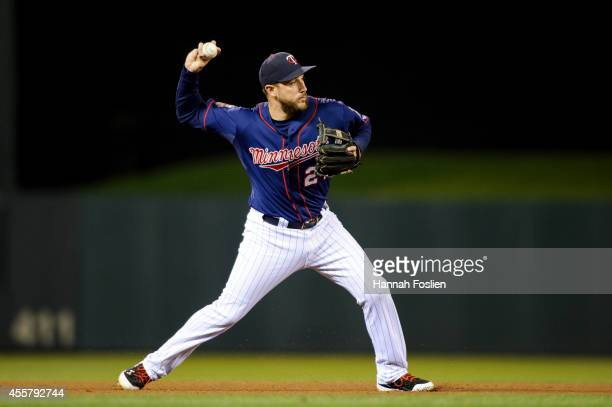Trevor Plouffe of the Minnesota Twins makes a play at third base during the game against the Detroit Tigers on September 16 2014 at Target Field in...
