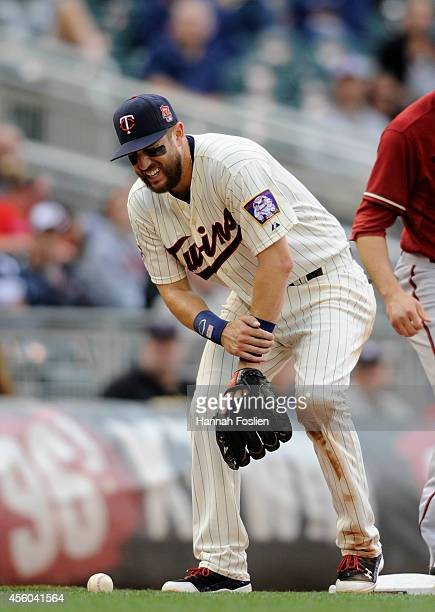 Trevor Plouffe of the Minnesota Twins reacts after being injured as AJ Pollock of the Arizona Diamondbacks stole third base during the sixth inning...