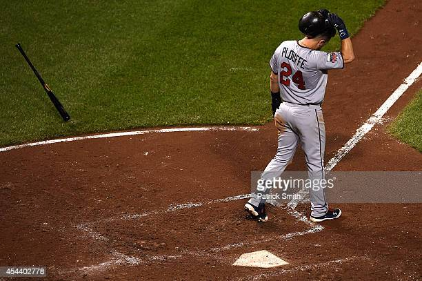Trevor Plouffe of the Minnesota Twins reacts after striking out in the fifth inning against the Baltimore Orioles at Oriole Park at Camden Yards on...