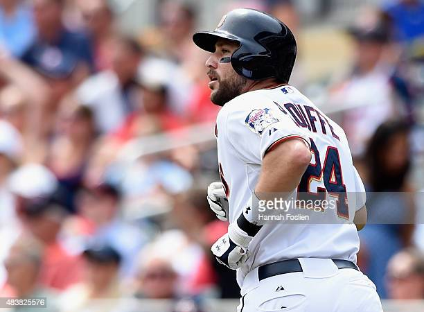 Trevor Plouffe of the Minnesota Twins rounds the bases after hitting a solo home run against the Texas Rangers during the second inning of the game...