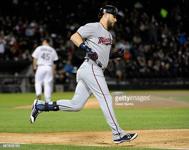 Trevor Plouffe of the Minnesota Twins runs the bases after hitting a home run against the Chicago White Sox during the fourth inning on September 11...