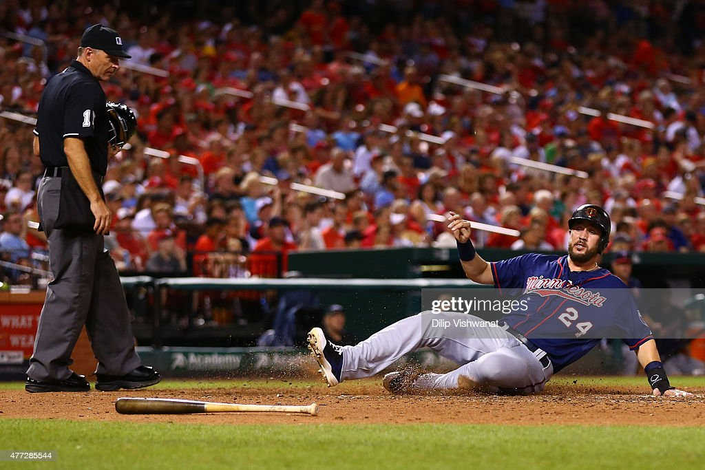 Trevor Plouffe #24 of the Minnesota Twins scores a run against the St. Louis Cardinals in the seventh inning at Busch Stadium on June 15, 2015 in St. Louis, Missouri.