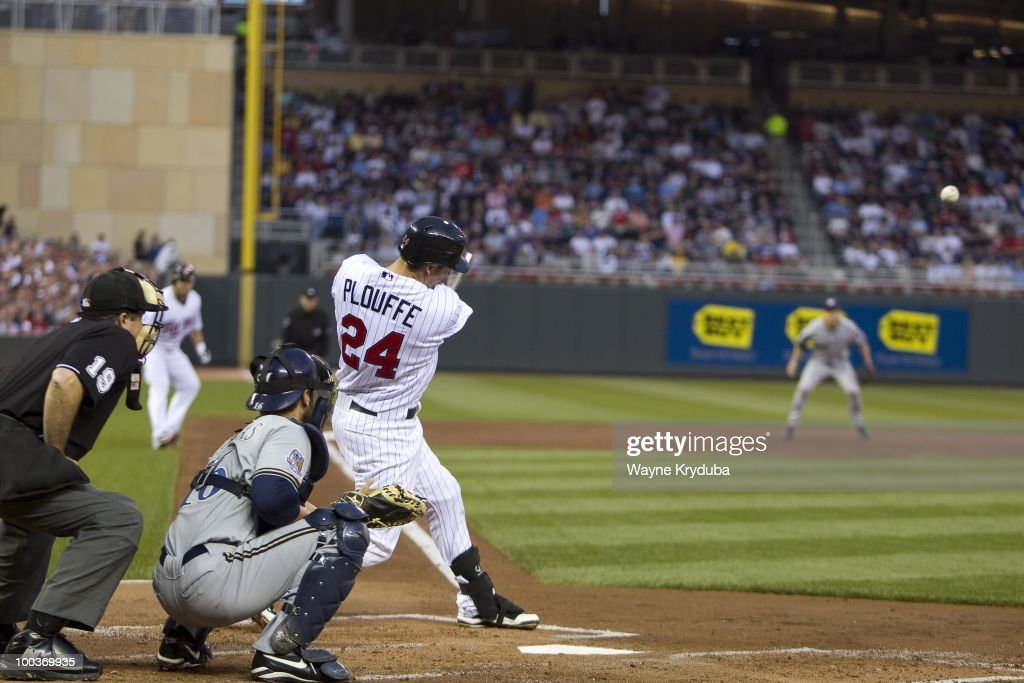 Trevor Plouffe #24 of the Minnesota Twins singles in his first career at bat during the MLB game against the Milwaukee Brewers on May 21, 2010 at Target Field in Minneapolis, Minnesota. The Twins won 15-3.