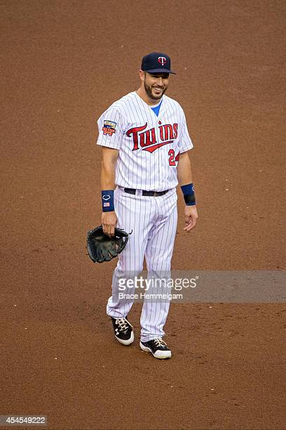 Trevor Plouffe of the Minnesota Twins smiles against the Chicago White Sox on July 24 2014 at Target Field in Minneapolis Minnesota The White Sox...