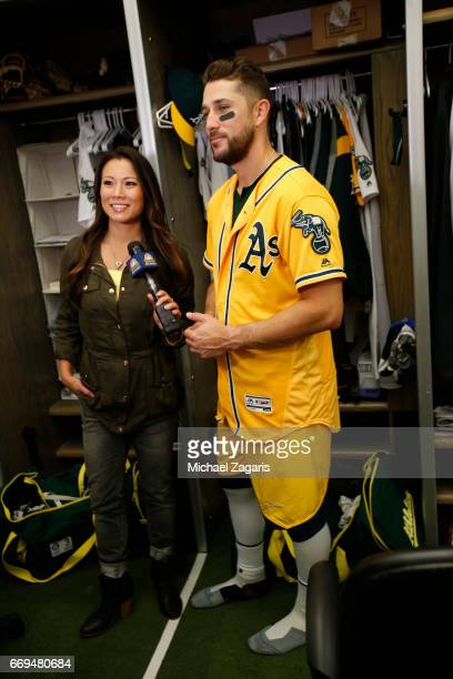Trevor Plouffe of the Oakland Athletics talks with the media in the clubhouse following the game against the Los Angeles Angels of Anaheim at the...