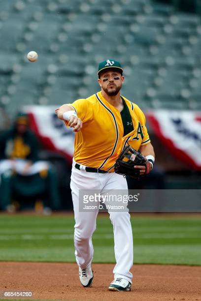 Trevor Plouffe of the Oakland Athletics throws to first base after fielding a ground ball hit off the bat of Carlos Perez of the Los Angeles Angels...