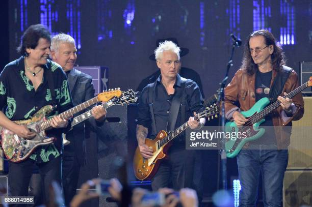 Trevor Rabin Alex Lifeson Mike McCready and Geddy Lee onstage at the 32nd Annual Rock Roll Hall Of Fame Induction Ceremony at Barclays Center on...