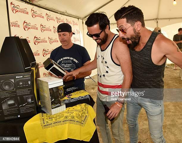 Trevor Rosen Brad Tursi and Matthew Ramsey of Old Dominion backstage at Kicker Country Stampede Manhattan Kansas Day 1 on June 25 2015 in Manhattan...