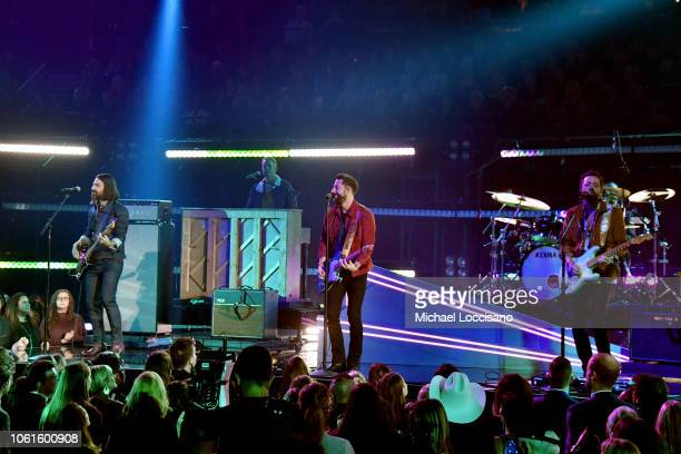 Trevor Rosen Geoff Sprung Matthew Ramsey and Brad Tursi of Old Dominion performs onstage during the 52nd annual CMA Awards at the Bridgestone Arena...