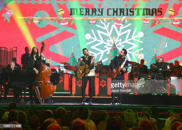 Trevor Rosen Geoff Sprung Matthew Ramsey Brad Tursi and Whit Sellers of Old Dominion perform during the 2018 CMA Country Christmas at Curb Event...