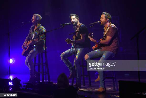 Trevor Rosen Matthew Ramsey and Brad Tursi of Old Dominion perform at the Ryman Auditorium on September 18 2018 in Nashville Tennessee