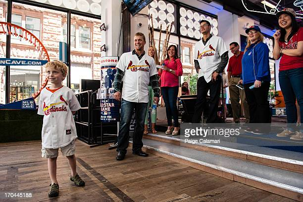Trevor Rosenthal and Joe Kelly of the St Louis Cardinals meet a young fan at the MLB Fan Cave Wednesday June 12 at Broadway and 4th Street in New...
