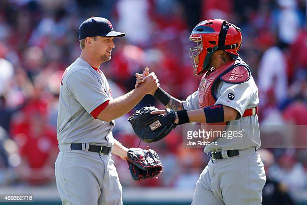 Trevor Rosenthal and Yadier Molina of the St Louis Cardinals celebrate after the final out of the ninth inning after the game against the Cincinnati...