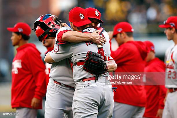 Trevor Rosenthal and Yadier Molina of the St Louis Cardinals celebrate defeating the Pittsburgh Pirates in Game Four of the National League Division...