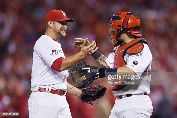 Trevor Rosenthal of the St Louis Cardinals celebrates with Yadier Molina of the St Louis Cardinals after defeating the Chicago Cubs in game one of...