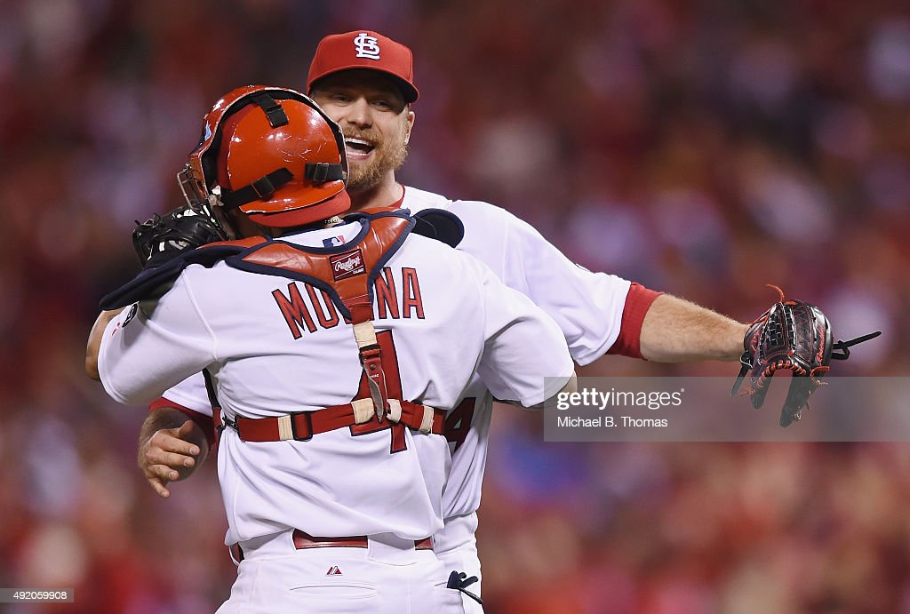 Trevor Rosenthal #44 of the St. Louis Cardinals celebrates with Yadier Molina #4 of the St. Louis Cardinals after defeating the Chicago Cubs in game one of the National League Division Series at Busch Stadium on October 9, 2015 in St Louis, Missouri. The St. Louis Cardinals defeat the Chicago Cubs with a score of 4 to 0.