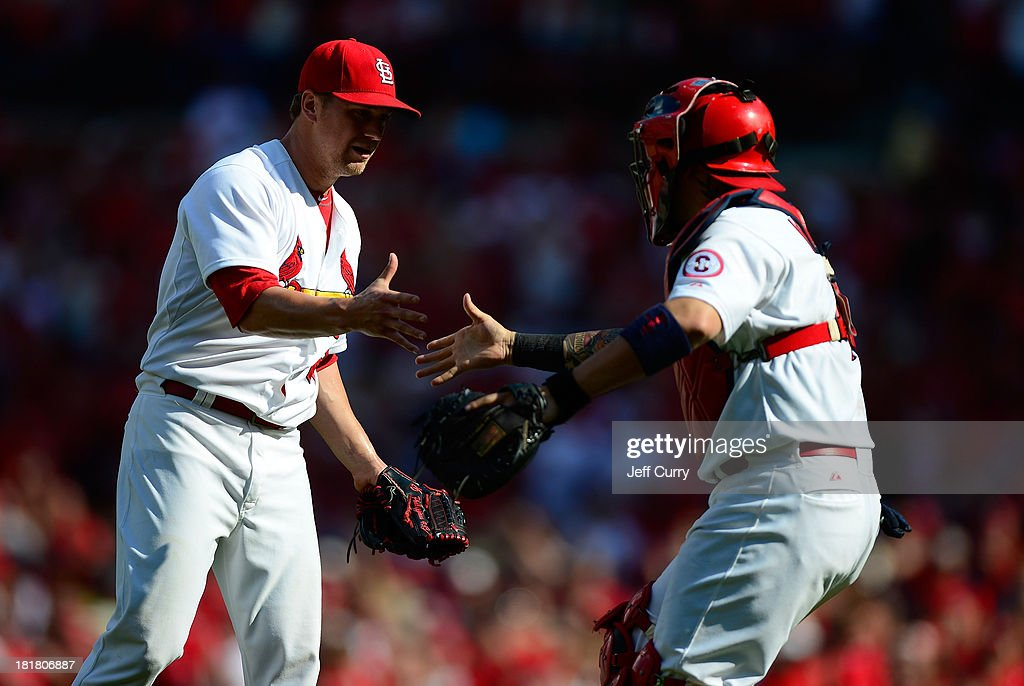Trevor Rosenthal #26 of the St. Louis Cardinals celebrates with Yadier Molina #4 after closing out the ninth inning against the Washington Nationals at Busch Stadium on September 25, 2013 in St. Louis, Missouri. The Cardinals won 4-1 to sweep the Nationals.
