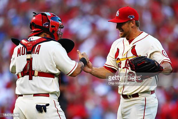 Trevor Rosenthal of the St Louis Cardinals celebrates with Yadier Molina after their 1 to 0 win over the Los Angeles Dodgers during Game Two of the...