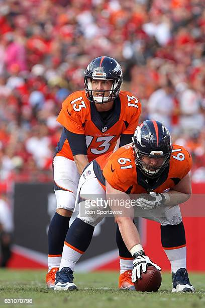 Trevor Siemian of the Broncos waits for the snap of the football from center Matt Paradis during the NFL game between the Denver Broncos and Tampa...