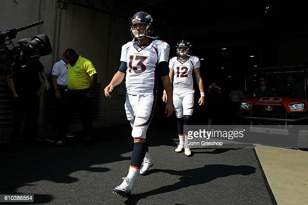 Trevor Siemian of the Denver Broncos and Paxton Lynch of the Denver Broncos walk out to the field prior to the start of the game against the...