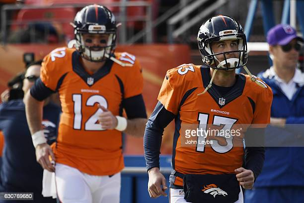 Trevor Siemian of the Denver Broncos and Paxton Lynch take the field before the first quarter against the Oakland Raiders on Sunday January 1 2017...