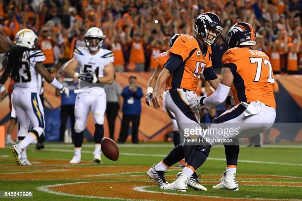 Trevor Siemian of the Denver Broncos is celebrates his touchdown with teammate Garett Bolles during the second quarter of action The Denver Broncos...