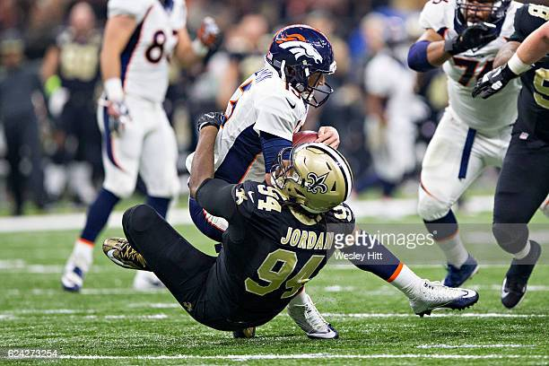 Trevor Siemian of the Denver Broncos is sacked by Cameron Jordan of the New Orleans Saints at MercedesBenz Superdome on November 13 2016 in New...