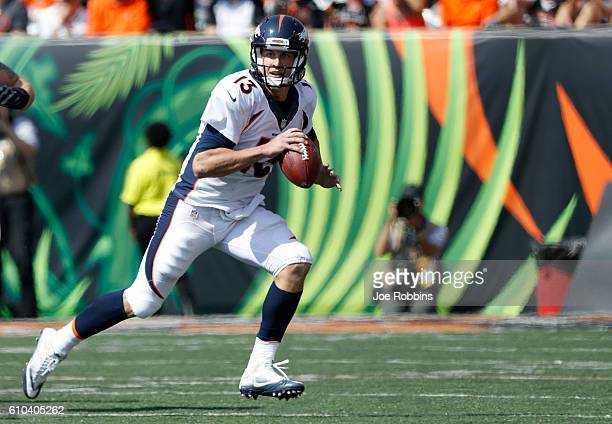 Trevor Siemian of the Denver Broncos scrambles with the ball during the first quarter of the game against the Cincinnati Bengals at Paul Brown...