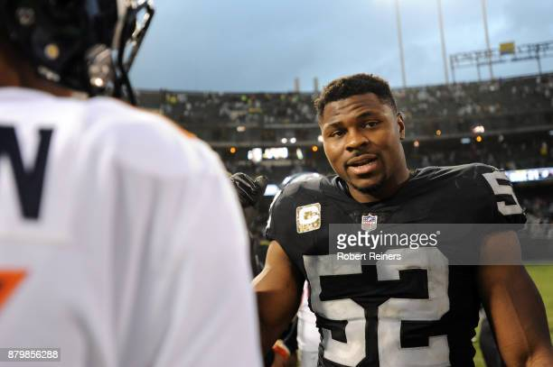 Trevor Siemian of the Denver Broncos speaks with Khalil Mack of the Oakland Raiders after the Oakland Raiders defeat of the Denver Broncos 2114 in...