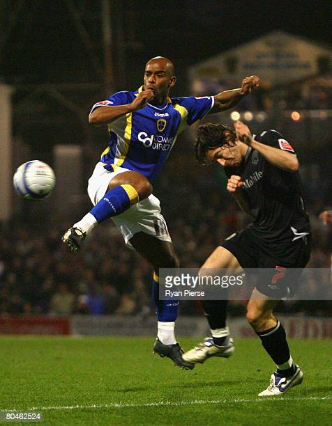 Trevor Sinclair of Cardiff City competes for the ball against Robert Koren of West Bromwich Albion during the Coca Cola Championship match between...