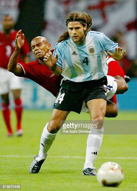 Trevor Sinclair of England is challenged by Mauricio Pochettino of Argentina during the FIFA World Cup Korea/Japan Group F match between Argentina...