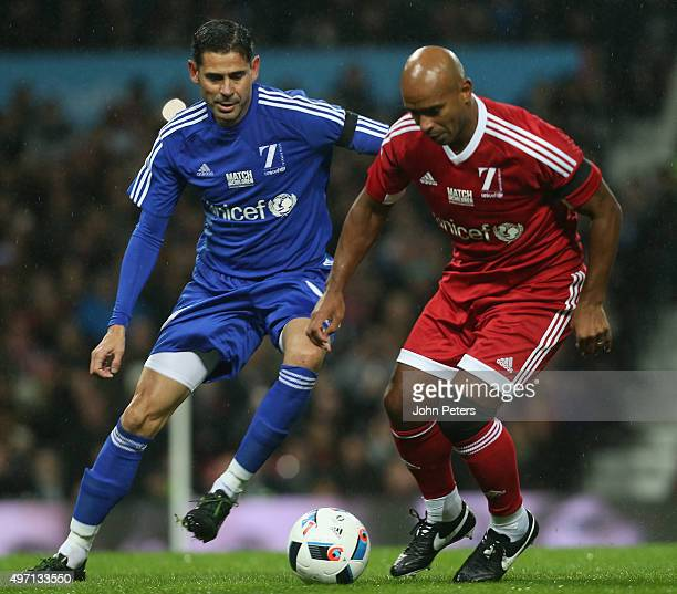 Trevor Sinclair of Great Britain and Ireland in action with Fernando Hierro of Rest of the World during the David Beckham Match for Children in aid...